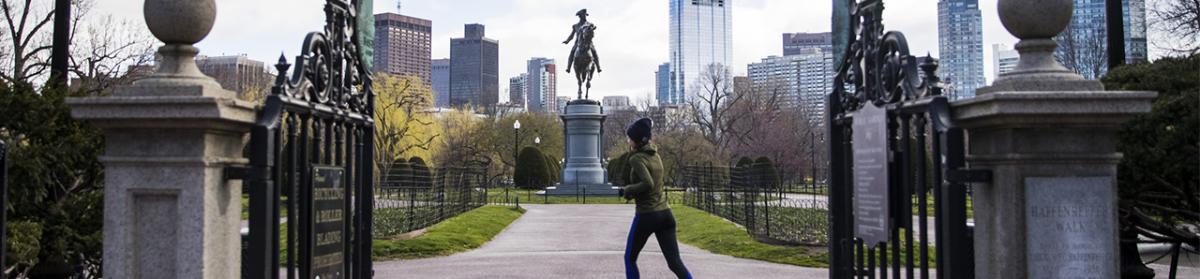 A person runs in the Boston Public Garden in Boston, Massachusetts, U.S., on April 1. Photographer: Adam Glanzman/Bloomberg